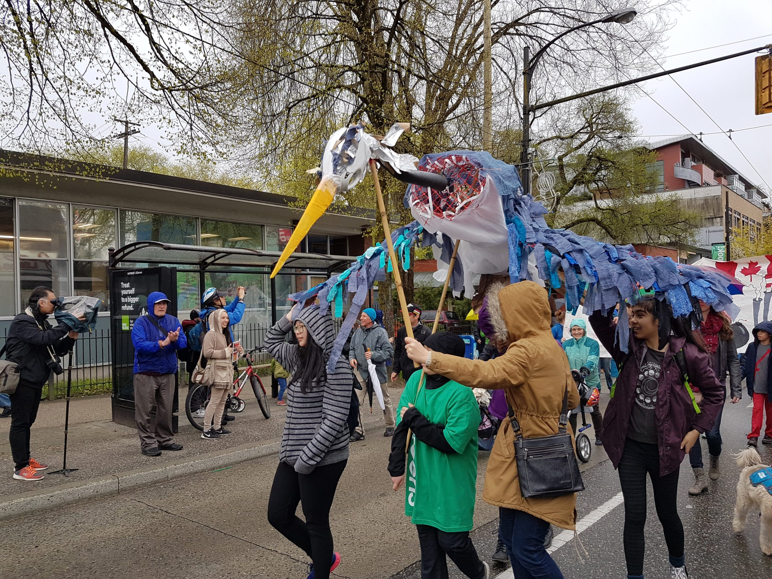 Windermere youth carrying puppetry at the Earth Day Parade on Commercial Dr (Apr 2017) - Photo by Bea Miller